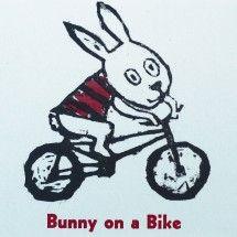 bunny on a bike letterpress postcard